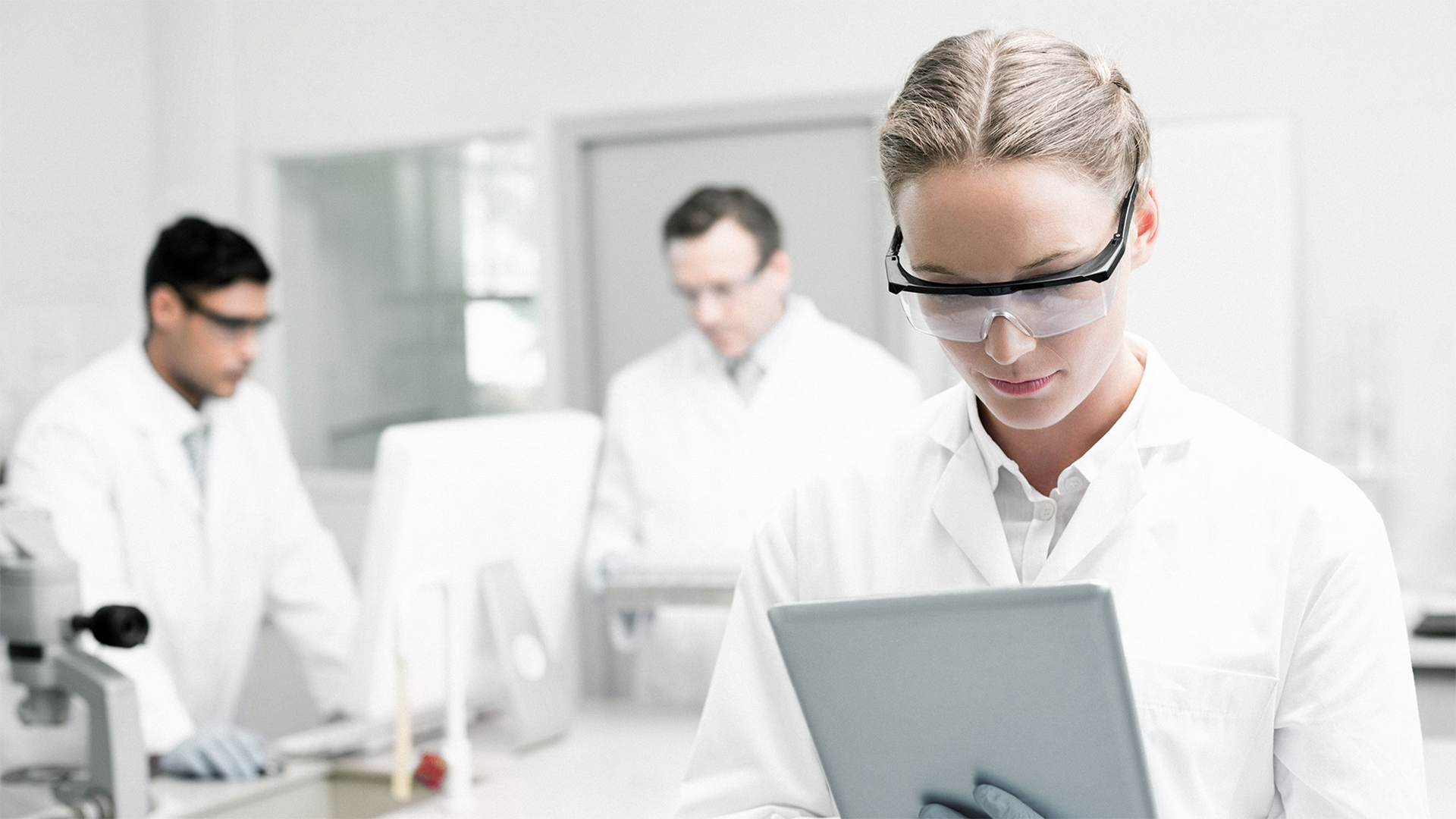 Woman looking at tablet computer in lab